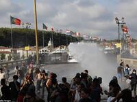 French security personnel fire a water canon during a protest in the city of Bayonne. (AFP/ File Photo)