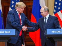 US President Donald Trump shakes hands with Russian President Vladimir Putin at the end of their summit in Helsinki, Finland, on Monday, July 16. (Yuri Kadobnov/AFP/Getty Images)