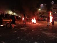 Protesters in Ramtha during small-scale riots that broke out on Friday that saw young people closing the main street in their northern district in protest against the government's decision to intensify measures on the Jaber border crossing with Syria. (Twitter)