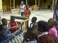 Young saxophonist Temilayo Abodurin (L) and pianist Joshua Akinotan play to motivate fellow children during a chess class at Ogolonto in Ikorodu district of Lagos, on August 17, 2019.  PIUS UTOMI EKPEI / AFP