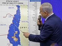 Israeli Prime Minister Benjamin Netanyahu points at a map of the Jordan Valley as he gives a statement in Ramat Gan, near the Israeli coastal city of Tel Aviv, on September 10, 2019. (AFP/ File Photo)