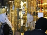 Women gaze at the window of a jewelry shop at the Bzourieh market in the centre of the Syrian.  LOUAI BESHARA / AFP