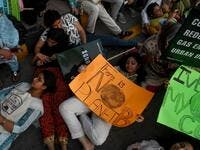"Youths hold placards as lie on the ground during a climate strike to protest against governmental inaction towards climate breakdown and environmental pollution, part of demonstrations being held worldwide in a movement dubbed ""Fridays for Future"", in Karachi on September 20, 2019. ASIF HASSAN / AFP"