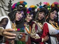 "Young Amazigh (Berber) women pose for a selfie photograph during the annual ""Engagement Moussem"" festival near the village of Imilchil in central Morocco's high Atlas Mountains on September 21, 2019. Each year in the High Atlas Mountains hamlet of Ait Amer, tribes celebrate with dances and music, the collective wedding of young Amazigh couples during the traditional festival of ""Engagement Moussem"". FADEL SENNA / AFP"