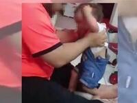A screen grab from a video that went viral, purportedly showing a man beating a child (social media)