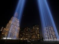 People look toward the Tribute in Light, lit up to commemorate the 18th anniversary of the September 11, 2001 attacks in New York, on Tuesday (Twitter)