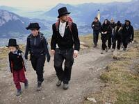 "Dozens of people dressed in black went on a ""funeral march"" up a steep Swiss mountainside on Sunday to mark the disappearance of an Alpine glacier amid growing global alarm over climate change (Twitter)"