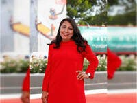 Saudi director Haifa Al Mansour wore a red dress by Jaeger-LeCoultre