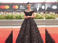 Saudi actress Mila Al Zahrani sported a black gown with feathers for her first look