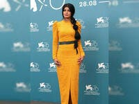 For her second appearance, she wore a mustard yellow dress designed by Eman Alajlan