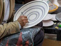 Artisan is painting dish, Berber style in ceramic factory, Fex Medina, Morocco. (Shutterstock/ File Photo)