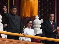 Chinese President Xi Jinping (C) attends a military parade with former presidents Hu Jintao (L) and Jiang Zemin in Tiananmen Square in Beijing on October 1, 2019, to mark the 70th anniversary of the founding of the PeopleÕs Republic of China. GREG BAKER / AFP