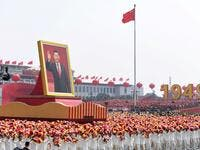 A float with a giant portrait of China's President Xi Jinping passes by Tiananmen Square during the National Day parade in Beijing on October 1, 2019, to mark the 70th anniversary of the founding of the People's Republic of China. GREG BAKER / AFP