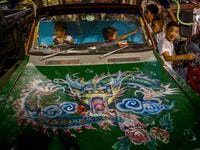 Children play in a car parked next to a Chinese shrine during the annual Vegetarian Festival in Phuket on October 2, 2019. Mladen ANTONOV / AFP