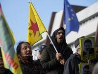 Kurdish demonstrators wave flags and hold portraits of Kurdish leader Abdullah Ocalan in front of the Council of Europe in Strasbourg, northeastern France, during a demonstration to protest against Turkey's military action in northern Syria on October 9, 2019. FREDERICK FLORIN / AFP