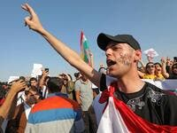 A Kurdish man shouts slogans during a demonstration in Arbil, the capital of the northern Iraqi Kurdish autonomous region (AFP)
