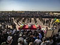 Mourners attend a funeral, for Kurdish political leader Hevrin Khalaf and others including civilians and Kurdish fighters, in the northeastern Syrian Kurdish town of Derik, known as al-Malikiyah in Arabic, on October 13, 2019.  (AFP/ File Photo)