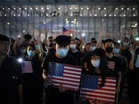 Protesters chant slogans as they attend a rally in Hong Kong on October 14, 2019, calling on US politicians to pass a bill that could alter Washington's relationship with the trading hub. (AFP/ File Photo)