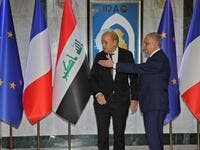 Iraqi Foreign Minister Mohammed Ali al-Hakim (R) meets his French counterpart Jean-Yves Le Drian in Baghdad on October 17, 2019. SABAH ARAR / AFP