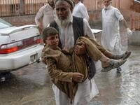 At least 28 worshippers were killed and dozens wounded by a blast inside an Afghan mosque during Friday prayers (AFP)
