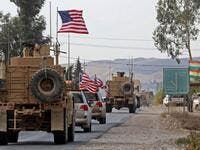 A convoy of US military vehicles arrives near the Iraqi Kurdish town of Bardarash in the Dohuk governorate after withdrawing from northern Syria on October 21, 2019. ( SAFIN HAMED / AFP)