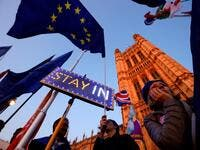 Banners, Union and EU flags are displayed outside the Houses of Parliament in London on October 22, 2019, as MPs debate the second reading of the Government's European Union (Withdrawal Agreement) Bill. (AFP/ File Photo)