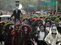 People take part in the Day of the Dead parade in Mexico City Ulises Ruiz/AFP/Getty Images