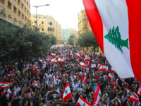 Lebanese demonstrators take part in a protest against dire economic conditions in Lebanon's southern city of Sidon on October 21, 2019. (IBRAHIM AMRO / AFP)