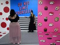 "A woman is being photographed at the ""Supercandy Pop-Up Museum Vol. 2"" in Cologne, western Germany on November 1, 2019. It is an interactive museum and offers a photo backdrop for social media at 25 stations. INA FASSBENDER / AFP"