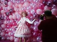 "Instagram influencer ""Anmaykaa"" is being photographed at the ""Supercandy Pop-Up Museum Vol. 2"" in Cologne, western Germany on November 1, 2019. It is an interactive museum and offers a photo backdrop for social media at 25 stations. INA FASSBENDER / AFP"