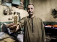 "An Egyptian confectioner shows a sweet sesame bar at a candy factory in the capital Cairo on November 2, 2019, ahead of celebrations of the Muslim Prophet Mohammed's birthday, known as ""Al Mawlid Al Nabawi"". Prophet Mohamed was born in Saudi Arabia's arid mountainous city of Mecca, the holiest in Islam, some 1490 years ago. Sunni Muslims in many parts of the world celebrate his birthday on the 12th day of the third month of the Islamic calendar, which will fall this year on November 9th.  Mohamed el-Shahed"