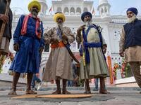 Sikh pilgrims gather as they take part in a ritual procession at a shrine in Nankana Sahib, some 75 kms west of Lahore on November 7, 2019, on the occasion of the 550th birth anniversary of Guru Nanak Dev. A corridor that will allow Sikhs to cross from India into Pakistan to visit one of the religion's holiest sites is set to open on November 9, with thousands expected to make a pilgrimage interrupted by decades of conflict. Arif ALI / AFP