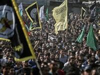 Mourners chant slogans as they carry the body of Palestinian Islamic Jihad senior leader Baha Abu Al-Ata during his funeral in Gaza City on November 12, 2019. Israel's military killed a commander of Palestinian militant group Islamic Jihad in a strike on his home in the Gaza Strip early, prompting retaliatory rocket fire and fears of a severe escalation in violence. MAHMUD HAMS / AFP