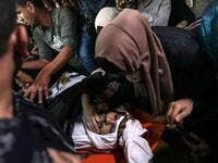 Palestinian relatives of Islamic Jihad militant Abdullah al-Belbasi mourn during his funeral in Beit Hanun in the northern Gaza Strip on November 13, 2019. Two more Palestinians were killed in an Israeli strike in the Gaza Strip, the enclave's health ministry said, as Israel said it was targeting rocket-launching squads and militant sites. The deaths brought the Gaza toll to 18 people killed since an exchange of fire began on Tuesday with an Israeli targeted strike on an Islamic Jihad commander sparking ret