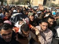 Palestinian mouners carry the body of Islamic Jihad militant Abdullah al-Belbasi during his funeral in Beit Hanun in the northern Gaza Strip on November 13, 2019. Two more Palestinians were killed in an Israeli strike in the Gaza Strip, the enclave's health ministry said, as Israel said it was targeting rocket-launching squads and militant sites. MAHMUD HAMS / AFP