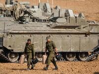 Israeli soldiers walk next to armoured vehicles near the border with the Gaza Strip on November 13, 2019. Israel launched deadly strikes against commanders of Palestinian militant group Islamic Jihad triggering a wave of tit-for-tat rocket salvos and air strikes that have killed 16 Palestinians in two days. (Menahem KAHANA / AFP)