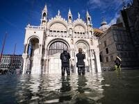 A general view shows the flooded St. Mark's Square, with St. Mark's Basilica (C) on November 14, 2019 in Venice. Much of Venice was left under water after the highest tide in 50 years ripped through the historic Italian city, beaching gondolas, trashing hotels and sending tourists fleeing through rapidly rising waters. Filippo MONTEFORTE / AFP