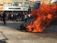 Iranian protesters gather around a burning motorcycle during a demonstration against an increase in gasoline prices in the central city of Isfahan, on November 16, 2019. AFP