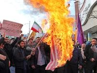 "Iranian men burn a US flag during a protest in support of the Islamic republic's government and supreme leader, Ayatollah Ali Khamenei, in the northwestern city of Ardabil on November 20, 2019, as President Hassan Rouhani said the country's people had defeated an ""enemy conspiracy"" behind a wave of violent street protests. (AFP/ File Photo)"