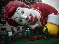 The Ronald McDonald balloon is kept under a net during the inflation process on November 27, 2019 in New York City. Winds could ground the giant balloons, according to city regulations, giant balloons cannot fly with gusts winds above 34 m.p.h. Eduardo Munoz Alvarez/Getty Images/AFP