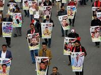 Iraqis hold pictures of killed demonstrators in the capital Baghdad's Tahrir Square, amid ongoing anti-government protests, on December 6, 2019. Tahrir has become a melting pot of Iraqi society, occupied day and night by thousands of demonstrators angry with the political system in place since the aftermath of the US-led invasion of 2003 and Iran's role in propping it up. AHMAD AL-RUBAYE / AFP
