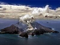 This file photo taken on November 29, 1999 shows New Zealand's most active volcano on White Island in the Bay of Plenty giving off dense plumes of steam and gas. New Zealand's White Island volcano erupted suddenly on December 9, 2019, prompting fears for a group of visitors seen walking on the crater floor moments before. TORSTEN BLACKWOOD / AFP