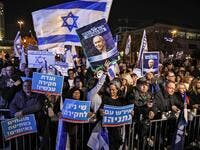 Israelis gather with signs and national flags during a demonstration in support of Prime Minister Benjamin Netanyahu in Jerusalem on December 11, 2019. AHMAD GHARABLI / AFP