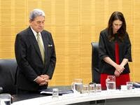 New Zealand Prime Minister Jacinda Ardern (C) and Deputy Prime Minister Winston Peters stand with cabinet ministers as they observe a minute's silence in respect for victims of the December 9 White Island volcanic eruption, at Parliament in Wellington on December 16, 2019. (AFP/ File Photo)