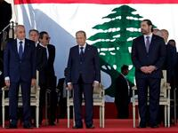 Lebanese Prime Minister Saad Hariri (R), President Michel Aoun (C) and House Speaker Nabih Berri (L) attend a military parade to celebrate the 75th anniversary of Lebanon's independence in downtown Beirut, on November 22, 2018 (AFP Photo/ANWAR AMRO)