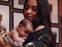 Shay had her daughter bundled up in a cozy white blanket as her little one rested in her mother's arms.