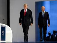 In this file photo taken on January 26, 2018, US President Donald Trump (L) arrives on stage followed by Founder and Executive Chairman of the World Economic Forum (WEF) Klaus Schwab before delivering his speech at the World Economic Forum (WEF) annual meeting in Davos, eastern Switzerland. (AFP)