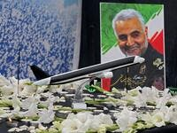 A poster of slain military commander Qasem Soleimani is seen at a memorial for the victims of the Ukrainian plane crash, in University of Tehran on January 14, 2020. Iran announced its first arrests over the shooting down of a Ukrainian airliner last week, as it struggles to contain the fallout from the disaster that sparked three days of protests. ATTA KENARE / AFP