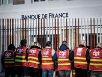 General Confederation of Labour (CGT) unionists of the Banque de France demonstrate outside a bank notes sorting centre of the Banque de France in La Courneuve, outside Paris, on January 22, 2020, as part of a nationwide multi-sector strike against the French government's pensions overhaul. STEPHANE DE SAKUTIN / AFP