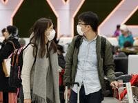 Travellers are seen wearing masks at the international arrivals area at the Toronto Pearson Airport in Toronto, Canada, January 26, 2020. Toronto Public Health confirmed Saturday that a case of the novel coronavirus that originated in Wuhan, China is currently being treated in a Toronto Hospital. Cole BURSTON / AFP